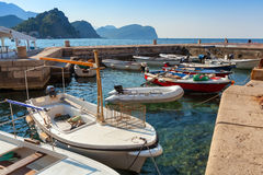 Fishing boats float moored in Adriatic sea. Water. Petrovac town, Montenegro stock images