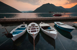 Fishing boats float moored in Montenegro. Fishing boats float moored in Perast port. Bay of Kotor, Montenegro royalty free stock photography