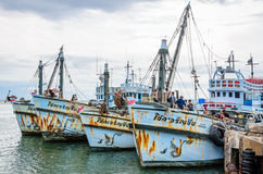 Fishing boats floating at harbor. stock image