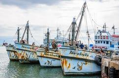 Fishing boats floating at harbor. Stock Image