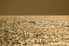 Fishing boats floating in the sea. Fishing boats floating in the sea with the golden light of the morning sun Stock Photography