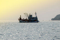 Fishing boats floating in the sea. Royalty Free Stock Photos