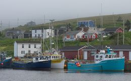 Fishing boats in Branch Harbour. Fishing boats in foggy harbour in Branch, Newfoundland and Labrador stock photo