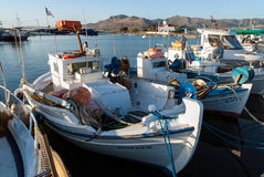 Fishing boats in Greece. Traditional wooden fishing boats in the harbor on October 12, 2013 in Elafonisos island of Peloponnese, Greece. Fishing in wooden Royalty Free Stock Images