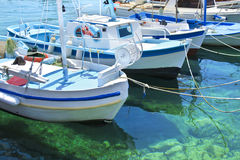 Fishing boats in greek Aegean island Stock Photos