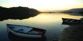 Fishing boats on Groenvlei Lake between Knysna & Sedgefield Stock Photo