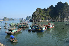 Fishing boats in Halong Bay, Vietnam. Designated a World Heritage site in 1994, Halong Bay& x27;s spectacular scatter of islands, dotted with wind- and wave Stock Photography