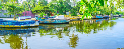 The fishing boats in Hamilton`s Canal, Wattala, Colombo. The fishing boats are reflected in waters of Hamilton`s Canal, Wattala suburb, Colombo, Sri Lanka Royalty Free Stock Photo