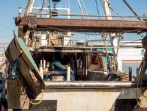Fishing boats in a harbor royalty free stock photo
