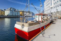 Fishing boats in the harbor of Alesund town, Norway. Port city background travel fjord old cityscape landscape architecture sea scandinavia norwegian beautiful royalty free stock photos