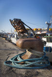 Fishing boats in harbor - bollard with blue rope Stock Photo