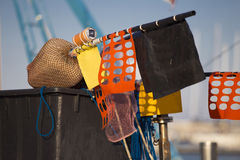 Fishing boats in harbor - buoy with flags Royalty Free Stock Photo
