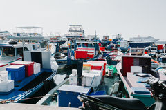 Fishing boats in the harbor in city Male, capital of Maldives Royalty Free Stock Photo