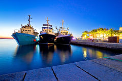 Fishing boats in harbor evening view Stock Photo