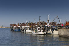 Fishing boats in harbor Stock Photos