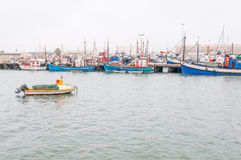 Fishing boats at the harbor in Luderitz Stock Photos