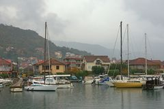 Fishing boats in harbor.  Marina Kalimanj in the town of Tivat on a foggy autumn day. Montenegro Royalty Free Stock Photography