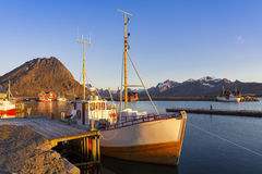 Fishing boats in harbor at midnight sun in Northern Norway, Lofo. Ten Island, Ramberg, Norway - Mountain In Background Stock Photography