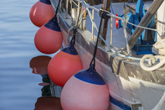 Fishing boats in harbor - pink balloons Royalty Free Stock Photo
