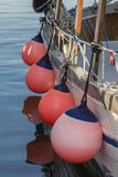 Fishing boats in harbor - pink balloons Stock Photo