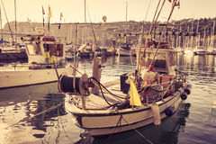 Fishing boats in harbor. Fishing boats in the port of Sistiana, Trieste, Italy . Photo in vintage style Stock Photography