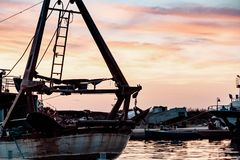Fishing boats in the fishing harbor stock photography