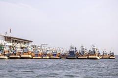 Fishing boats at the harbor Stock Photos