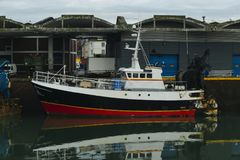 Fishing boats in a harbor. Trawler after fishing. Fishing industry, fishery. Commercial ship for seafoods in Dieppe Royalty Free Stock Photography