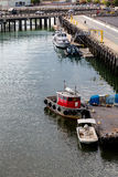 Fishing Boats and Harbormaster Stock Images