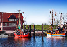 Fishing boats in the harbour Stock Photos