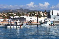 Fishing boats in the harbour, Caleta de Velez. Stock Photography