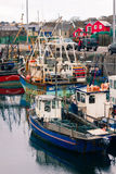 Fishing boats in the harbour.Dingle. Ireland. Picturesque and colourful fishing boats in the harbour. Dingle.  county Kerry. Ireland Royalty Free Stock Photography