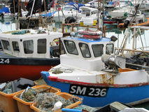 Fishing Boats in Harbour. Fishing boats docked in Brighton Beach harbour, England UK stock photo