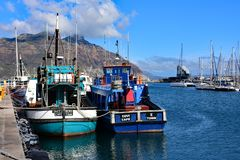 Fishing Boats in Harbour, Hout Bay, South Africa. Fishing Boats in Harbour at Hout Bay, Cape Peninsula, South Africa with Table Mountain in the background. Hout stock image
