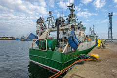 Fishing Boats in a Harbour,loading fish on refrigerated vehicles Stock Photography