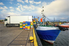 Fishing Boats in a Harbour,loading fish on refrigerated vehicles Stock Images