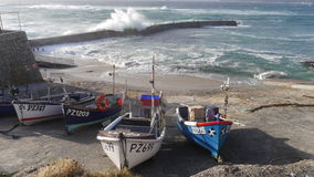 Fishing boats in the harbour at Sennen Cove in Cornwall UK. Fishing boats at high tide in Sennen Cove in Far West Cornwall in the UK Stock Image