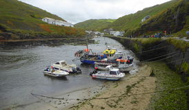 Fishing boats in harbour. Several small fishing boats moored in the harbour at Boscastle in Cornwall, England Stock Image