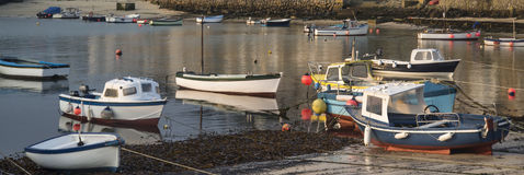 Fishing boats in harbour at sunrise Royalty Free Stock Images