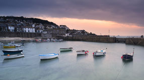 Fishing boats in harbour at sunrise. Long exposure image Royalty Free Stock Images