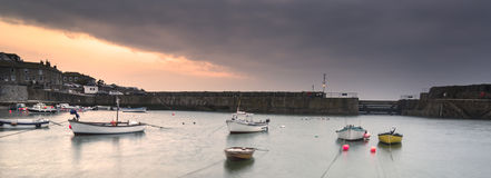 Fishing boats in harbour at sunrise Stock Photos