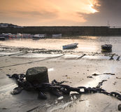 Fishing boats in harbour at sunrise Stock Photo