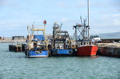 Fishing Boats in Harbour. Three fishing boats tied up in harbour Stock Images