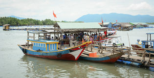 Fishing boats have a rest at the city river port in Vietnam Royalty Free Stock Photography