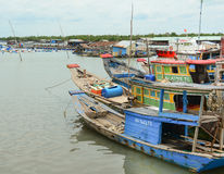 Fishing boats have a rest at the city river port in Vietnam Royalty Free Stock Images