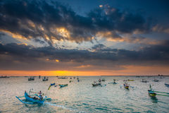 Fishing Boats heading out at sunset Stock Photos