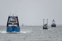 Fishing boats heading for shelter. NEW BEDFORD, MASSACHUSETTS - JANUARY 23, 2016: Fishing boats returning to port just ahead of winter storm Jonah Royalty Free Stock Photos
