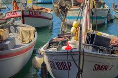 Fishing boats in the marina of camogli stock photo