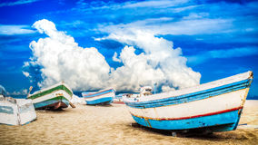 Fishing boats during a hot summer day on sand Stock Image