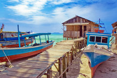 Fishing boats and hut at the seaside Stock Image
